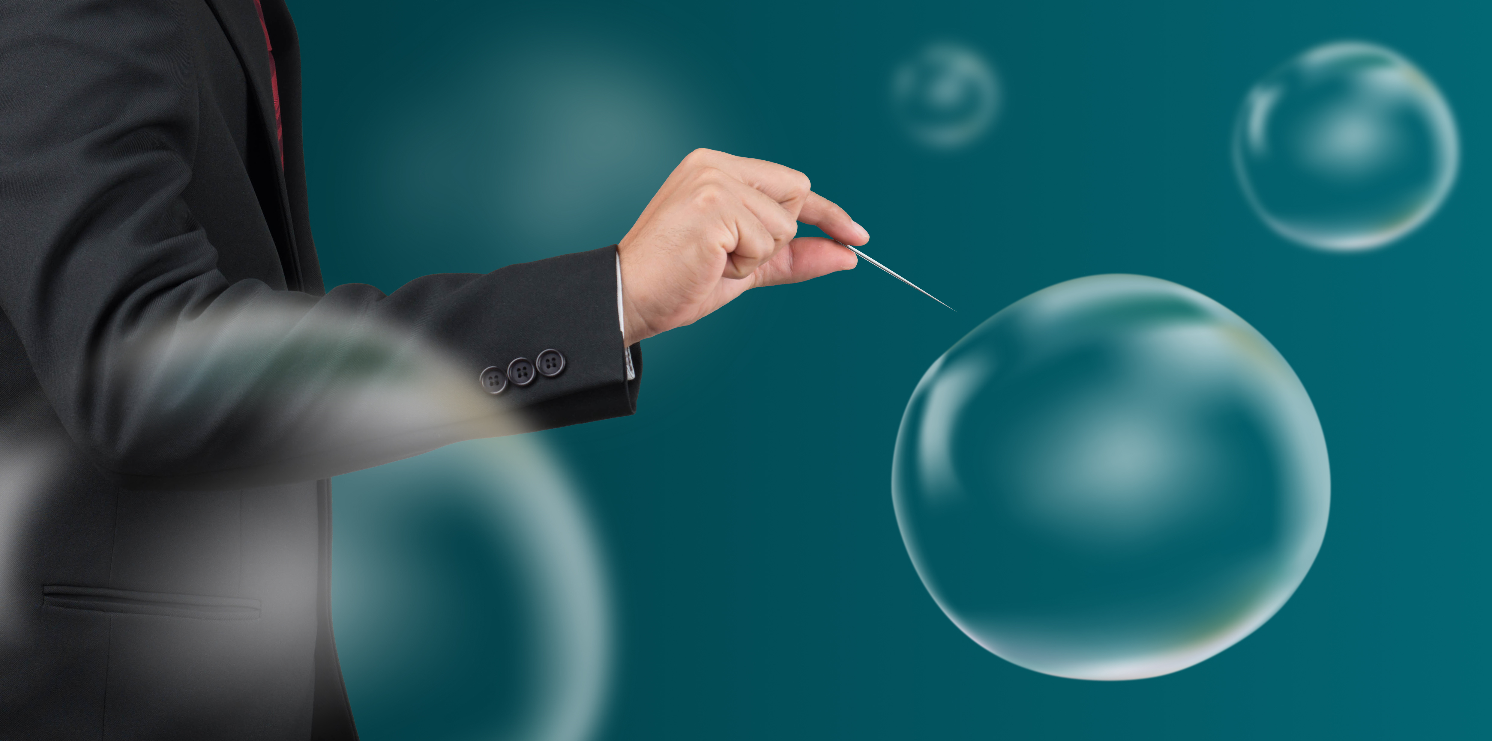 man hold needle stab an empty bubble